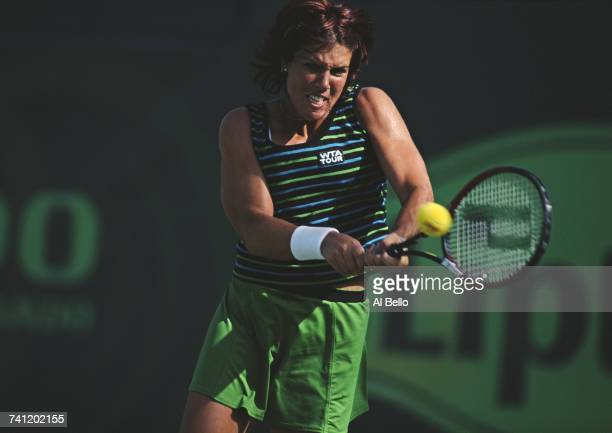 Jennifer Capriati of the United States eyes the ball for a double back hand return against Silvija Talaja during their Women's Singles first round...