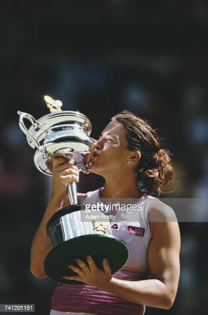 Jennifer Capriati of the United States kisses the trophy after winning the Women's Singles title against Martina Hingis at the Australian Open tennis...