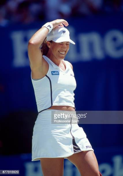 Jennifer Capriati of the USA celebrates after defeating Martina Hingis of Switzerland in the Women's Singles Final of the Australian Open Tennis...