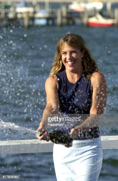 Jennifer Capriati of the USA celebrates with a bottle of champagne on the waterfront next to the Yarra River after defeating Martina Hingis of...