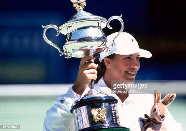 Jennifer Capriati of the USA celebrates with the trophy defeating Martina Hingis of Switzerland in the Women's Singles Final of the Australian Open...