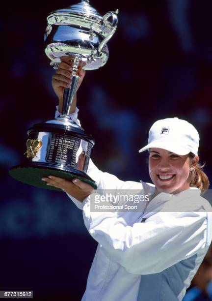 Jennifer Capriati of the USA lifts the trophy after defeating Martina Hingis of Switzerland in the Women's Singles Final of the Australian Open...