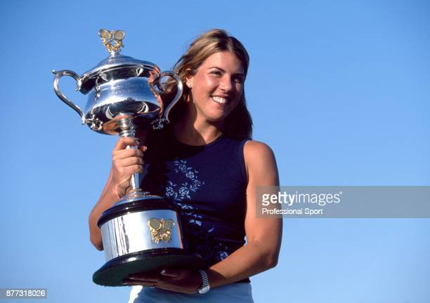 Jennifer Capriati of the USA poses with the trophy after defeating Martina Hingis of Switzerland in the Women's Singles Final of the Australian Open...