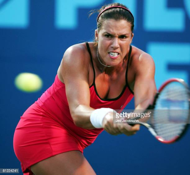 Jennifer Capriati of the USA returns a shot against Nathalie Dechy of France during the quaterfinals at the Pilot Pen Tennis tournament on August 26...
