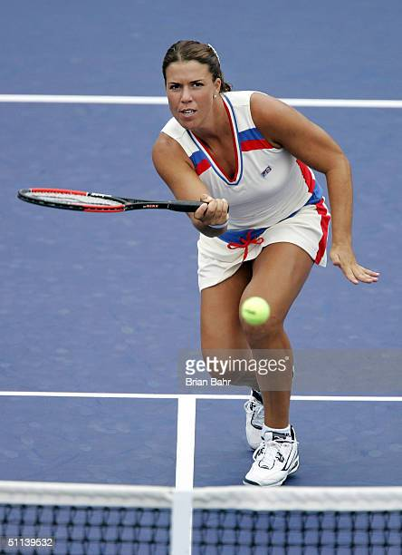 Jennifer Capriati of the USA rushes the net against Alina Jidkova of Russia during the second round of the Rogers Cup on August 3 2004 at Uniprix...