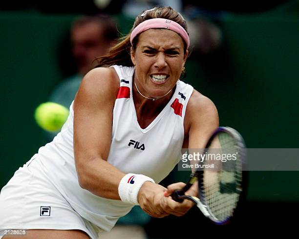 Jennifer Capriati of USA plays a backhand against Serena Williams of USA during the women's quarter finals at the Wimbledon Tennis Championships at...