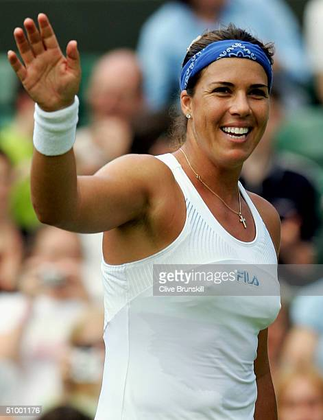 Jennifer Capriati of USA waves after she won her third round match against Nathalie Dechy of France at the Wimbledon Lawn Tennis Championship on June...