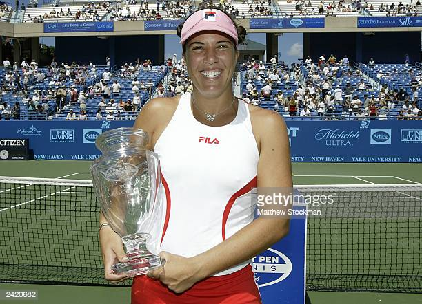 Jennifer Capriati poses for photographers after defeating Lindsay Davenport in the final during the Pilot Pen Tennis tournament on August 23, 2003 at...