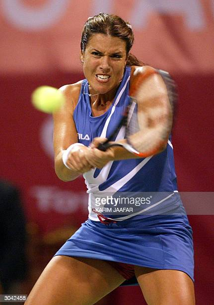 Jennifer Capriati returns the ball to Silvia Farina Elia of Italy during their quarter final match in the WTA Qatar Open tournament in Doha 04 March...