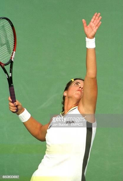 Jennifer Capriati serves up a big serve for Seda Noorlander.