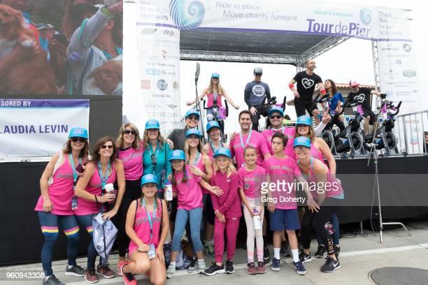 Jennifer Caras and Julies Angels rides at the 6th Annual Tour de Pier at Manhattan Beach Pier on May 20 2018 in Manhattan Beach California