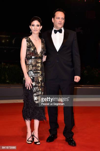 Jennifer Carpenter and Vince Vaughn walk the red carpet ahead of the 'Brawl In Cell Block 99' screening during the 74th Venice Film Festival at Sala...