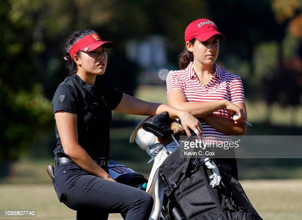 Jennifer Chang of the USC Trojans and Albane Valenzuela of the Stanford Cardinal communicate on the sixth tee during day three of the 2018 East Lake...