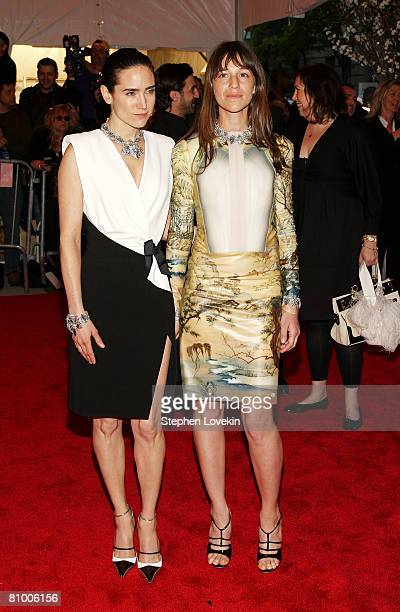 Jennifer Connelly and Charlotte Gainsbourg arrive at the Metropolitan Museum of Art Costume Institute Gala Superheroes Fashion and Fantasy held at...