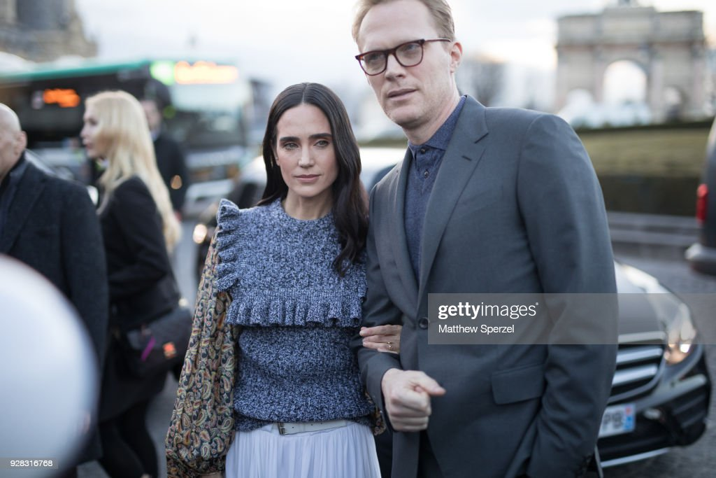 Jennifer Connelly and her husband Paul Bettany are seen on the street attending Louis Vuitton during Paris Women's Fashion Week A/W 2018 on March 6, 2018 in Paris, France.
