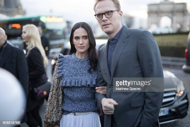 Jennifer Connelly and her husband Paul Bettany are seen on the street attending Louis Vuitton during Paris Women's Fashion Week A/W 2018 on March 6...