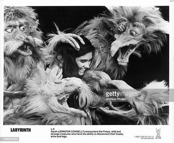 Jennifer Connelly is encountered by Fireys in a scene from the film 'Labyrinth', 1986.