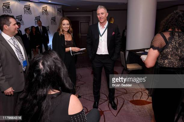 Jennifer Cooper and Chase Utley attend the Legends Reception during the 34th Annual Great Sports Legends Dinner To Benefit The Buoniconti Fund To...