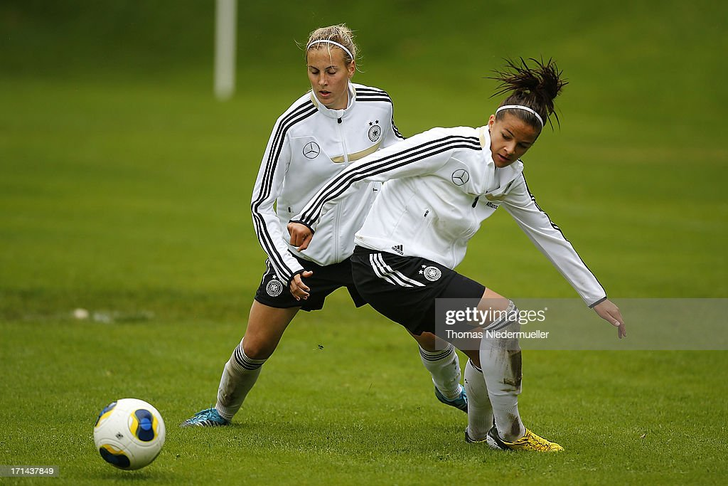Jennifer Cramer (L) fights for the ball with Lena Lotzen (R) during the German women's national team training session at HVB Club Sportzentrum on June 24, 2013 in Munich, Germany.