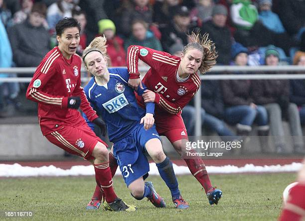 Jennifer Cramer of Potsdam challenges Clara Schoeneof Munich during the Women's Soccer Bundesliga Match between Bayern Muenchen and 1 FFC Turbine...