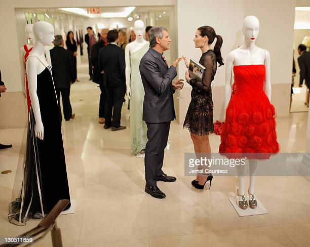 Jennifer Creel and Vice President of Worldwide Public Relations for Valentino Carlos Souza during the 100 Unforgettable Dresses book launch at the...