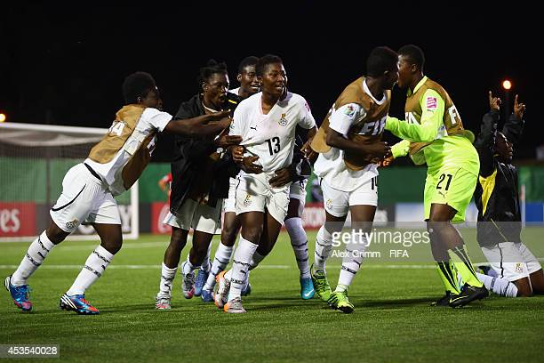 Jennifer Cudjoe of Ghana celebrates her team's second goal with team mates during the FIFA U20 Women's World Cup Canada 2014 group A match between...