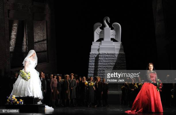30** Jennifer Davis as Elsa von Brabant and Christine Goerke as Ortrud with artists of the company in Richard Wagner's Lohengrin directed by David...