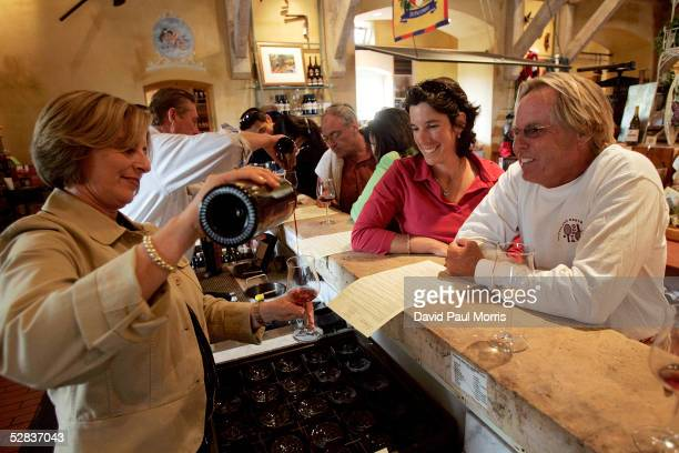 Jennifer Delgreco pours wine for Wendy Huffman and Kent Ryan at the Vianasa Winery May 16 2005 in Napa Valley California The Supreme court voted to...