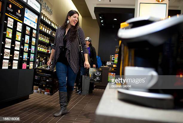 Jennifer Diciccio, of Waltham, Mass., was number eight in line to receive a free Keurig coffee brewer at the opening of the new Keurig store in the...