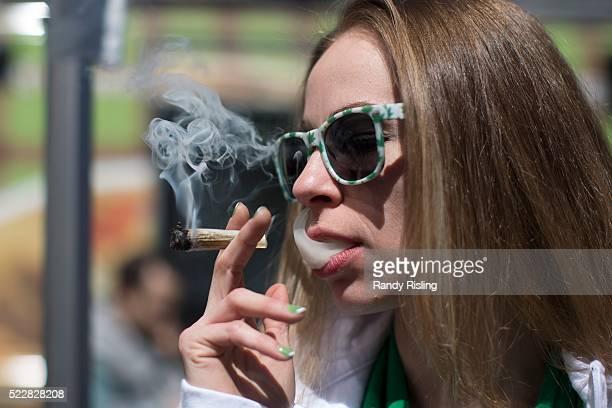 TORONTO ON APRIL 20 Jennifer Dobbs takes a toke at 420 celebrations at Yonge Dundas square Health Minister Jane Philpott says Canada will introduce...