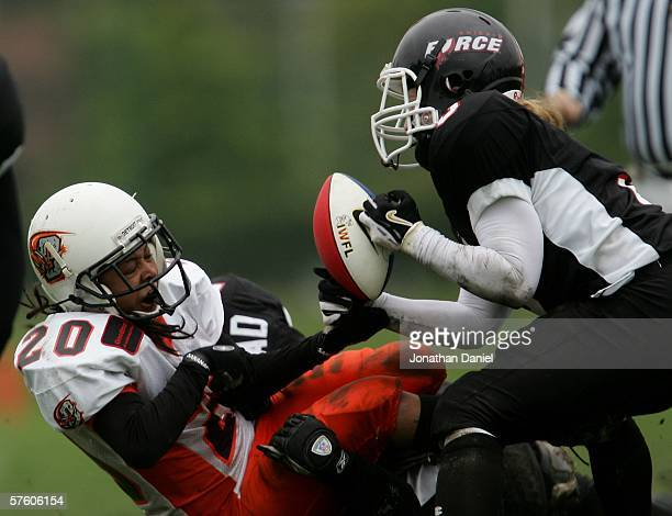 Jennifer Dulski of the Chicago Force pulls the ball away from Kiana Dennis of the Detroit Demolition during an Independent Women's Football League...