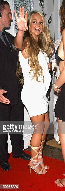 Jennifer Ellison gestures as he arrives to celebrate her Heaven and Hell themed 21st birthday party at Jewel on June 16 2004 in London England...