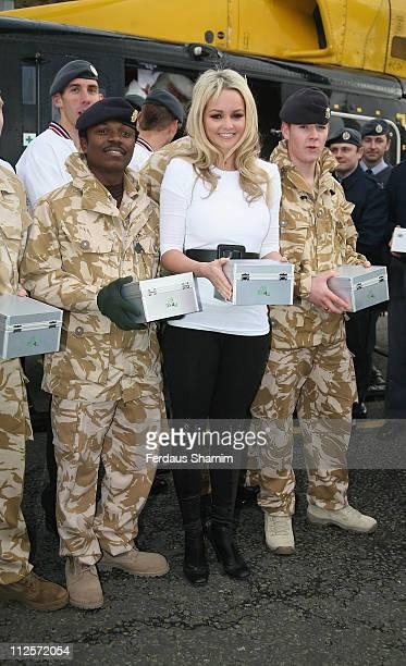 Jennifer Ellison pose with British Forces at a Photocall for UK4U Thanks Presents For Britsh Forces Abroad at Regents Park Barracks November 232007...