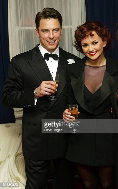 Jennifer Ellison poses in her new role as Roxie Hart with John Barrowman in the West End musical Chicago at the Adelphi Theatre on September 20 2004...