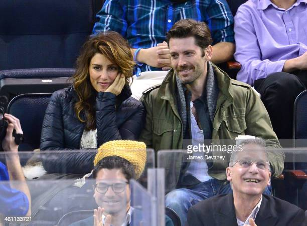 Jennifer Esposito and guest attend the Columbus Blue Jackets vs New York Rangers game at Madison Square Garden on January 6 2014 in New York City