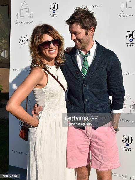 Jennifer Esposito and Louis Dowler attend the Petit Maison Chic Charity Fashion Show Benefiting Beyond Type 1 on August 27 2015 in Bridgehampton New...