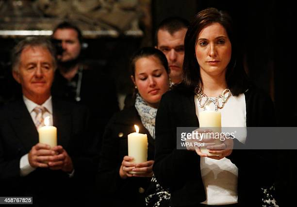 Jennifer Evans a niece of one of the victims of the Lockerbie bombing holds a memorial candle alongside other friends and relatives during a service...