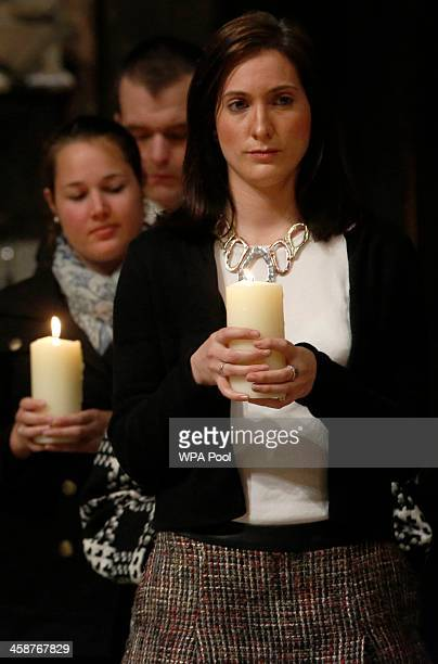 Jennifer Evans a niece of one of the victims of the Lockerbie bombing holds a memorial candle with other friends and relatives during a service of...
