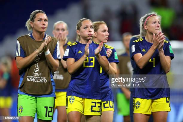 Jennifer Falk Elin Rubensson and Hanna Glas of Sweden acknowledge the fans following defeat in the 2019 FIFA Women's World Cup France Semi Final...