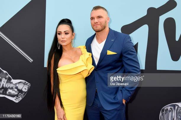 Jennifer Farley and Clayton Carpinello attend the 2019 MTV Video Music Awards at Prudential Center on August 26, 2019 in Newark, New Jersey.