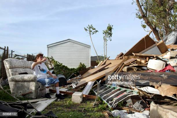 Jennifer Farrington sits on a couch in the middle of a pile of debris after Hurricane Wilma came through on October 24 2005 in the Palma Nova motor...