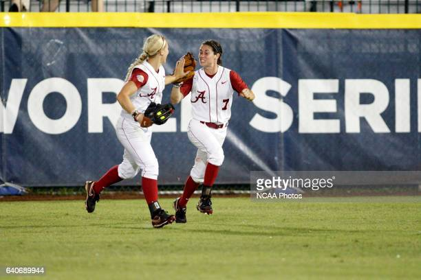 Jennifer Fenton of the University of Alabama congratulates teammate Jazlyn Lunceford on a catch against the University of Oklahoma during the...