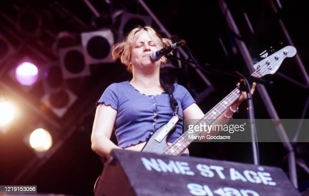 Jennifer Finch of L7 performs on stage at Glastonbury Festival, United Kingdom, 1994.
