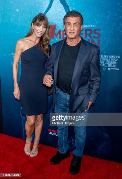 Jennifer Flavin and Sylvester Stallone attend the LA Premiere of 47 Meters Down UNCAGED on August 13 2019 in Los Angeles California