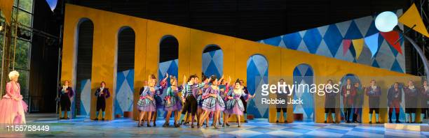Jennifer France as Princess Elsbeth with artists of the company in Garsington Opera's production of Jacques Offenbach's Fantasio directed by Martin...