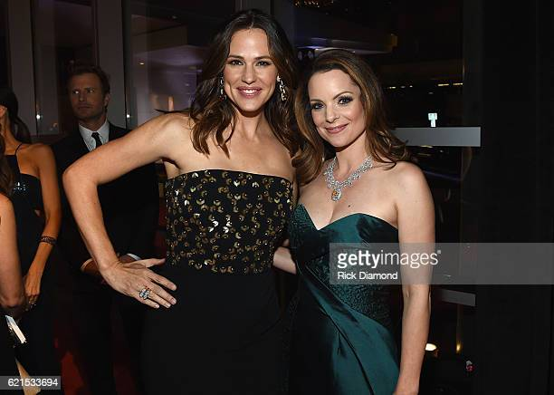 Jennifer Gardner and Kimberly Williams Paisley wearing Jonathon Arndt custom design 'Heart of the South Diamond' attend the 50th annual CMA Awards at...