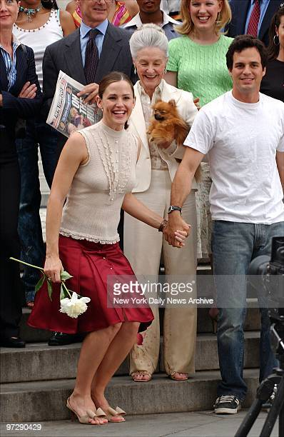 Jennifer Garner and Mark Ruffalo stand handinhand at the head of a happy throng on the steps of the New York Public Library on Fifth Ave while...