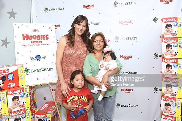 Jennifer Garner talks with moms about the better value of Huggies Snug Dry Diapers and helps donate 15 million diapers to Baby2Baby families in need...