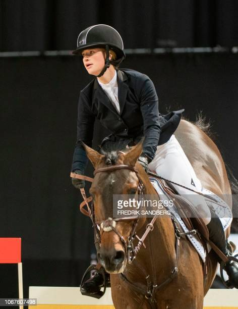 Jennifer Gates of the US rides her horse Capital Colorado during the Grand Prix international jumping event at the Sweden International Horse Show at...