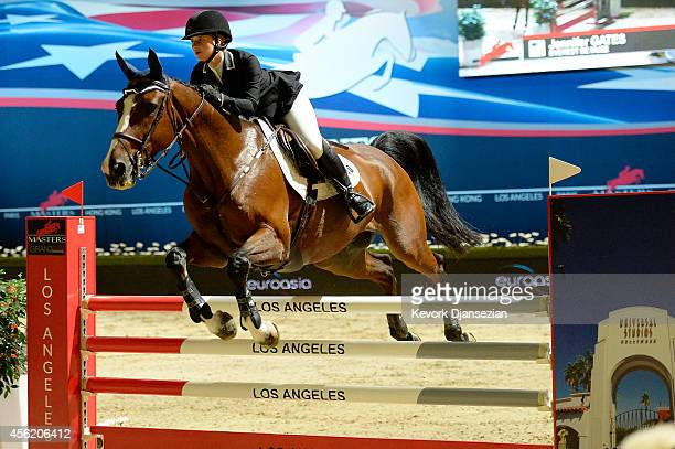 Jennifer Gates rides Everest de Muze during the Masters Grand Slam Trophy class at Longines Los Angeles Masters at Los Angeles Convention Center on...